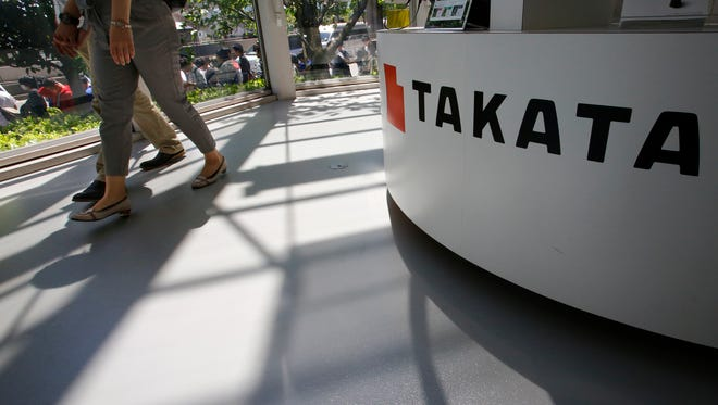 Takata Corp. at an automaker's showroom in Tokyo Wednesday, May 4, 2016. U.S. auto safety regulators have expanded a recall of Takata air bag inflators, already the biggest auto recall in American history.