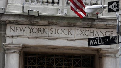 This Thursday, Oct. 2, 2014, file photo, shows the Wall Street entrance of the New York Stock Exchange. European markets were mixed Wednesday as investors awaited the European Central Bank's decision Thursday on another wave of economic stimulus. Asian markets rose. Britain's FTSE 100 added 0.7 percent to 6,665.44 at midday while France's CAC 40 was down 0.3 percent to 4,433.69 and Germany's DAX dipped 0.2 percent to 10,234.13. U.S. stocks were set to open lower, with Dow futures slipping 0.3 percent to 17,400. Broader S&P 500 futures fell 0.2 percent to 2,012.70. Many in the markets are betting that the European Central Bank will throw the continent's stricken economy another lifeline on Thursday.