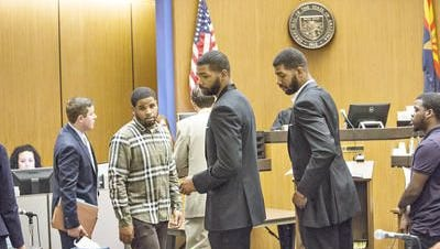 Phoenix Suns players Marcus Morris (left) and his Markieff Morris appear in court in front of Judge Jeffrey Rueter at Maricopa County Superior Court on June 30, 2015.
