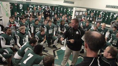 Mason coach Brian Castner speaks to his team before the playoff game against Springboro Nov. 7.