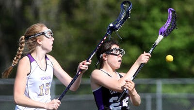 Kara Turco (left) and the Monroe girls lacrosse team hosted South Plainfield in the GMC Tournament on Tuesday.