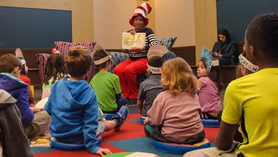 School Board member Mary Morrison reads to children at the Lafayette Public Library during a Read Across America celebration Feb 27, 2016.