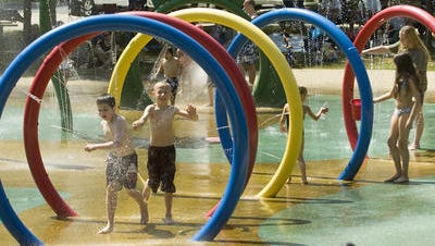 Children play in the Plymouth Township sprayscape. Township and city of Plymouth officials are planning a community survey that could lead to a joint recreation plan.