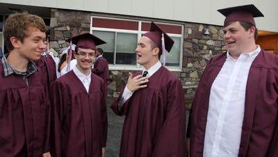 Graduates in 2012 chat at New Paltz High School's graduation.