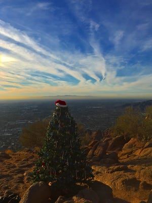It's beginning to look a lot like Christmas at the top of Camelback Mountain. Ricardo Tzintzun of Mesa found this holiday surprise at the summit of his hike. See more of his photos at instagram.com/_zinzun_.