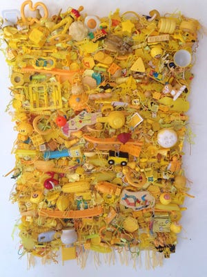 """Elizabeth Morisette's """"Fun & Games"""" features a selection of woven tapestries of toys and board games."""