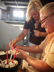 Heather Burnside of 1460-AM KXNO and Ed Wilson of WHO-HD sample the Bauder Mud ice cream creation, one among many new Iowa State Fair foods.