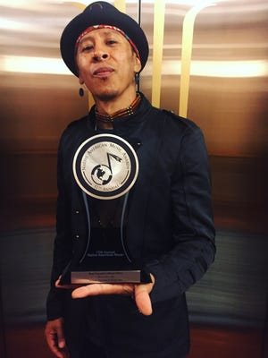 Rapper and native El Pasoan Artson holds his Nammy Award for Best Narrative Music Video.