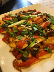 Thinly-sliced potatos with scallions and house-made