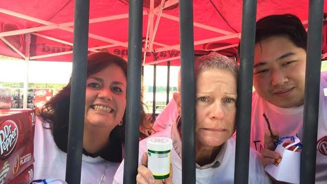 Pictured are 2014 Jail-n-Bail participants Micah Woodull of Sierra Blanca Pharmacy, Coleen Widell of HEAL & The Nest and Glen Cheng of Farmer's Insurance.