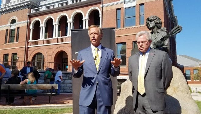 Gov. Bill Haslam, left, announces record tourism spending revenues for Tennessee with Commissioner of Tourism Development Kevin Triplett Tuesday, Aug. 30, 2016, at the Sevier County Courthouse.