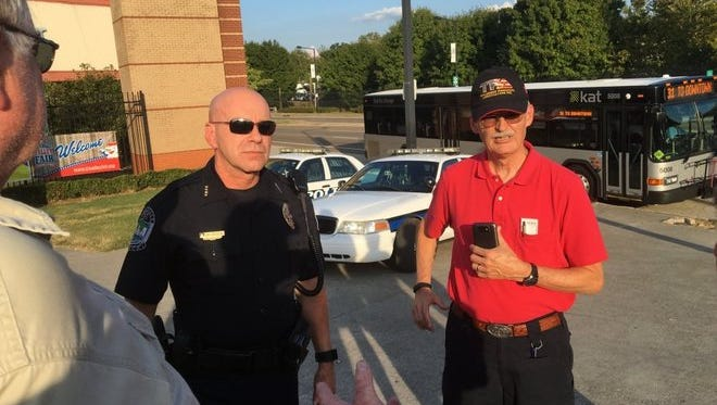 Knoxville Police Department Deputy Chief Monty Houk confirms handgun carry permit holders entering the Tennessee Valley Fair face arrest if armed. Liston Matthews, on right, with the Tennessee Firearms Association, records the conversation.