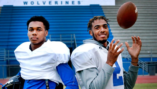 La Vergne wide receiver Josh Lewis (left) and quarterback Keianthony Conner pose following Wednesday's practice. The two have put up huge passing numbers for the Wolverines this season.