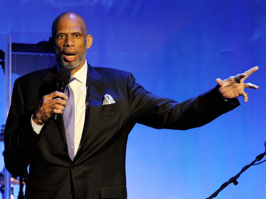 FILE - This Oct. 11, 2014, file photo shows retired basketball Hall of Famer Kareem Abdul-Jabbar addresings the audience during the 2014 Carousel of Hope Ball in Beverly Hills, Calif.  Abdul-Jabbar is recovering after undergoing quadruple coronary bypass surgery. A hospital statement on Friday, April 17, 2015, says Abdul-Jabbar had the surgery on Thursday at Ronald Reagan UCLA Medical Center. The doctor who performed the surgery, says the 68-year-old former NBA and UCLA star is expected to make a full recovery. (Photo by Chris Pizzello/Invision/AP,File)