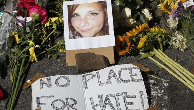 A makeshift memorial of flowers and a photo of victim Heather Heyer sits in Charlottesville, Va., on Aug. 13. Heyer died when a car rammed into a group of people who were protesting the presence of white supremacists who had gathered in the city for a rally.