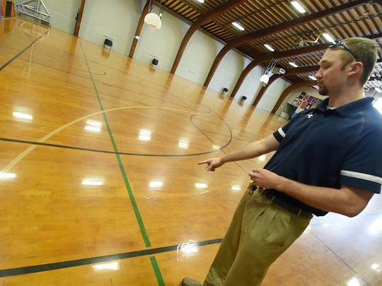 Hugh Ortner, a recreation specialist with the York Public Works Department, points to evidence of a 3-point-line from a semi-professional team that once played at the Voni B.Grimes Gym in York.