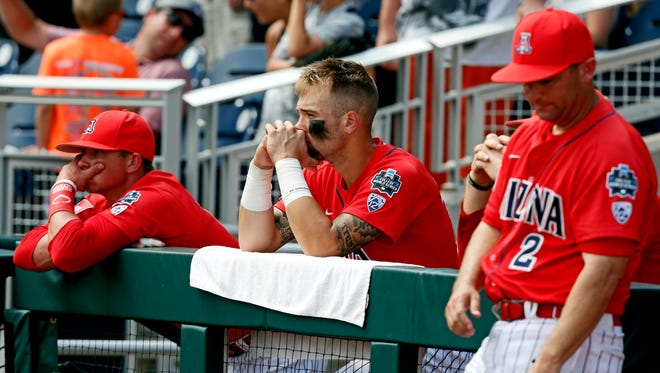 Arizona Wildcats players react after losing to the Coastal Carolina Chanticleers in game three of the College World Series championship series at TD Ameritrade Park.