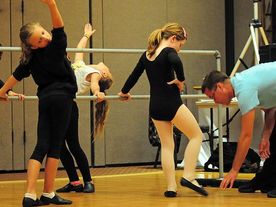 Students at the Iskra Ukrainian Dance Academy in Whippany do ballet exercises under the watchful eye of artistic director Andrij Cybyk at a Sept. 22 rehearsal, in preparation for performing Saturday, Oct. 3 at the Ukrainian American Cultural Center of New Jersey's 6th Annual Festival.
