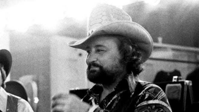 Tompall Glaser sits in the dressing room before performing with the Glaser Brothers during Fan Fair at Municipal Auditorium, June 12, 1981.