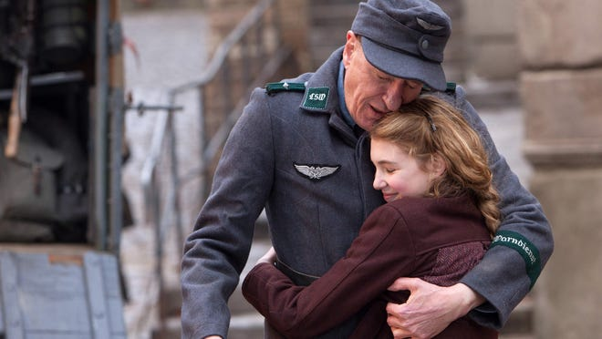 "Geoffrey Rush, and Sophie Nelisse star in ""The Book Thief,"" a WWII drama about a girl who secretly saves books from burning."