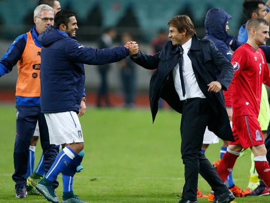 Italy's Eder, left, and  head coach Antonio Conte celebrate their victory after the Euro 2016 group H qualifying soccer match between  the Azerbaijan and Italy at the Olympic stadium in Baku, Azerbaijan, Saturday, Oct. 10, 2015. (AP Photo/Mindaugas Kulbis)