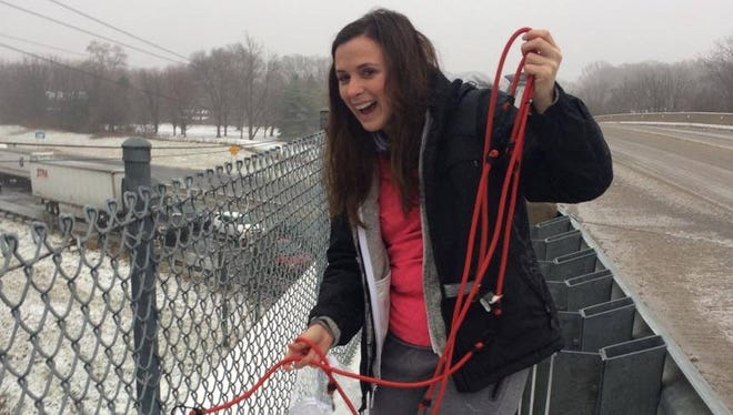 Sheila Trgovac lowers gasoline, water, breakfast burritos and snacks to her brother Matt Trgovac and his fiance, stuck on I-465 below the overpass for more than 10 hours.