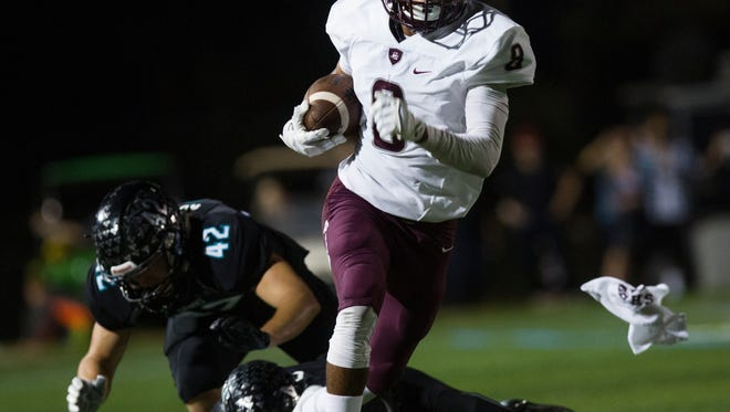 Braden River senior, Taj Speight, runs toward the end zone after dodging the Gulf Coast Sharks on Friday, November 11, 2016 at Gulf Coast High School in North Naples. Fridays between the Gulf Coast Sharks and the Braden River Pirates game was the first round of playoffs for class 7a.