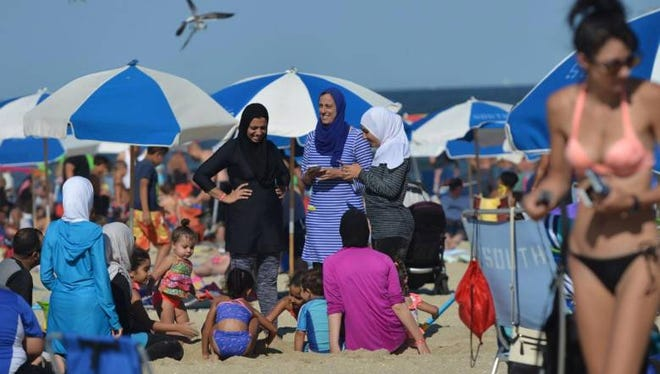 Amanny Khattab, center, wearing a burkini with her family at Point Pleasant Beach.
