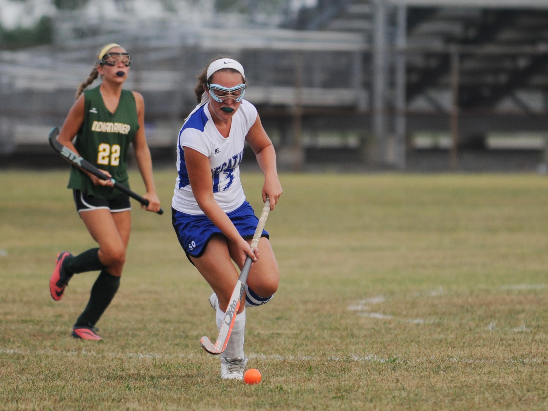 Stephen Decatur midfielder Sara Mitrecic works the ball up field against Indian River.