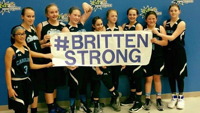 The Team Carolina Asheville sixth-grade girls basketball team.