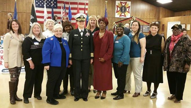 Female veterans surround keynote speaker Captain Heidi C. Agle following the inaugural Female Veterans Appreciation luncheon and ceremony.