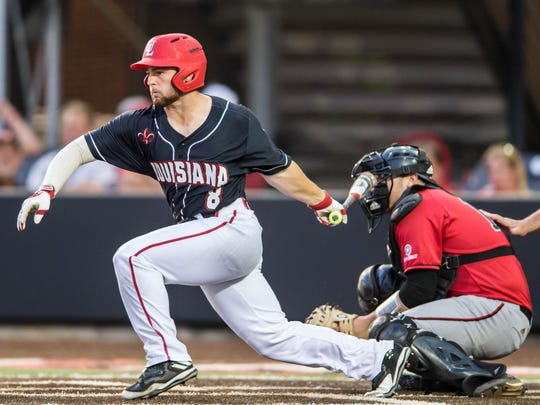 UL outfielder Zach LaFleur with the base hit as the Ragin' Cajuns play Arkansas State in the first of a three-game series, Thursday night on April 13, 2017.