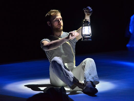 Actor/dancer Luca Tomao is bathed in blue and white light as he creates the sea-themed story of Blue! during a closed performance Thursday, May 1 at the College of St. Benedict's Gorecki Family Theater.