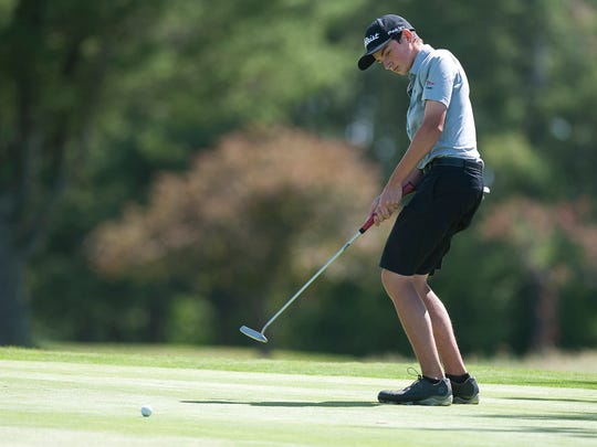 Rutland's Logan Broyles reacts to a putt on the 17th