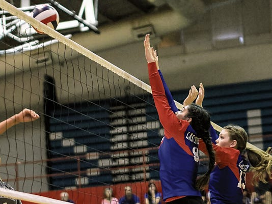 Jeremy Perlman -- For the Sun-News   Las Cruces High's Givy Padilla (9) and Emily DeRuyter (13) go up for a block against El Paso Chapin Tuesday night in the Bulldawgs' season opener at Las Cruces High School.