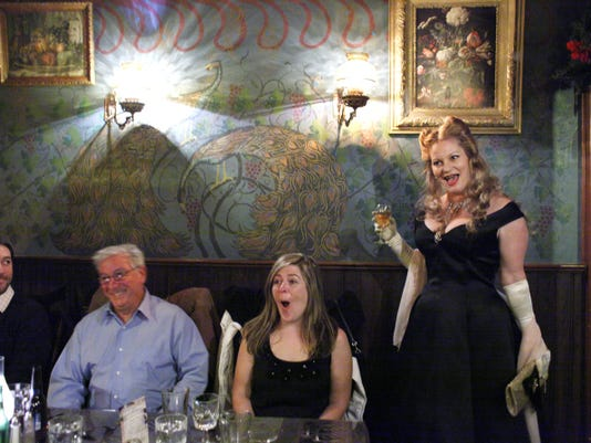 (Left to right) Guests John Emerich of Myerstown, Ernie Rhine of Myerstown and Mandy Lanson of Lebanon and Kate Hopkins, performing as the toy Barb-lee, react to another guest's raunchy comment during a murder mystery dinner at Bube's Brewery in Mt. Joy.