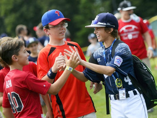 Red Land's Braden Kolmansberger greets fans before the Little League World Series championship on Sunday. Red Land lost the title game to Tokyo, Japan, 18-11.