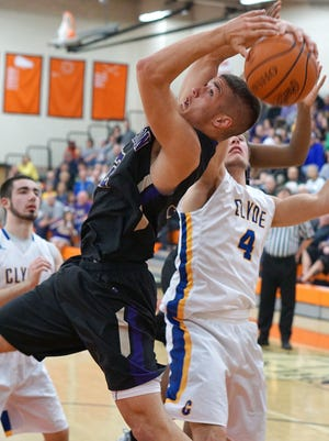 Jaycob Stone of Lexington and Eric Hull of Clyde battle for a rebound Tuesday night at Ashland High School.