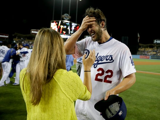 Los Angeles Dodgers starting pitcher Clayton Kershaw celebrates his no hitter with his with Ellen against the Colorado Rockies after a baseball game in Los Angeles, Wednesday, June 18, 2014. (AP Photo/Chris Carlson)