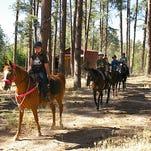 Campers can enjoy a horseback ride on trails through the adjacent Prescott National Forest.