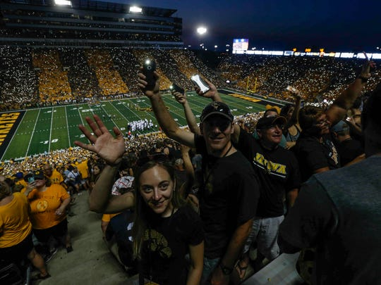Iowa fans wave their cell phone flashlights to the children at the University of Iowa Hospitals and Clinics Children's Hospital at the end of the first quarter against Penn State on Saturday, Sept. 23, 2017, at Kinnick Stadium in Iowa City.