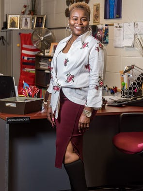 Angela Ringgold shows off her style at her workplace,