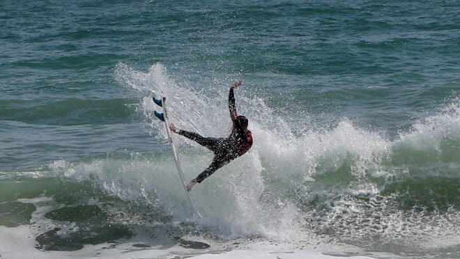 A surfer competes Saturday in the Eye of the Storm benefit contest at Paradise Beach Park in Indialantic.