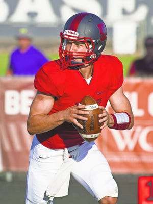 Dixie State quarterback Blake Barney looks for an open receiver against Central Washington in St. George on Sept. 12.