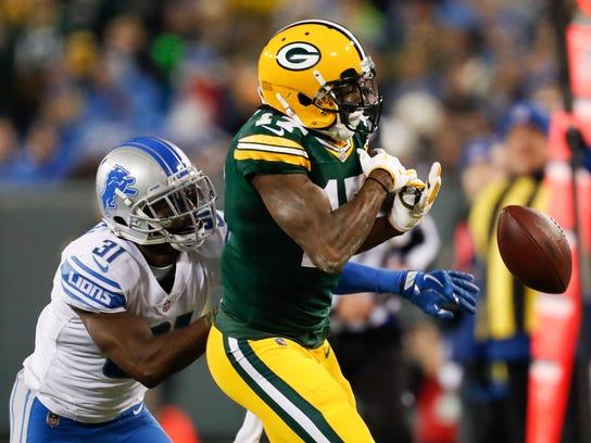 DJ Hayden breaks up a pass intended for Packers WR Davante Adams in the first half Monday.