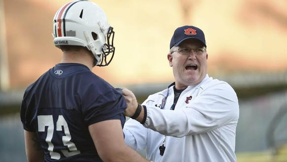 Auburn offensive line coach Herb Hand is trying to