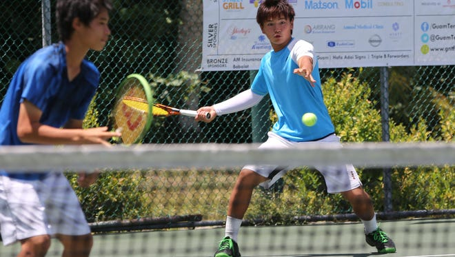 Seita Watanabe prepares to deliver a forehand return as doubles partner Kai Kawano tracks his opponents' movements during the Boys Doubles championship match of the 2016 Chuck E. Cheese's ITF Junior Championships at the Rick Ninete Tennis Center in Hagåtña Friday. Watanabe/Kawano lost to Ryuya Ata/Syunya Maruyama, 1-6, 7-5, 5-10.