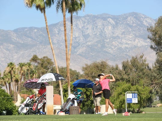 Golfers tee off during a practice round in preparation of the AJGA tournament at Mission Hills Country Club in Rancho Mirage, June 13, 2017.
