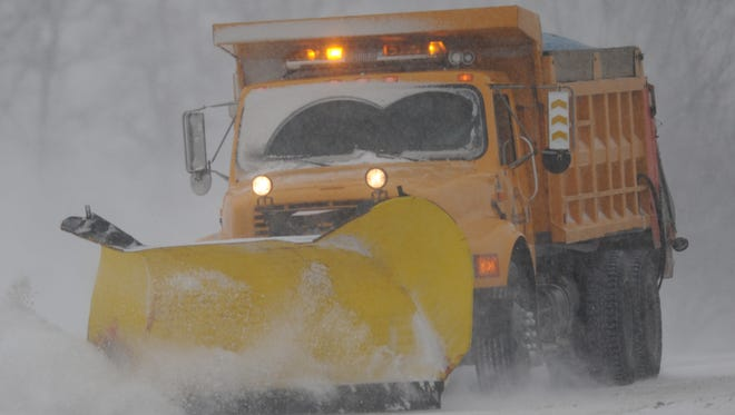 A city snow plow clears Industrial Parkway on Richmond's east side.