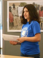 Watkins Glen student Miranda Rodriguez, director of the Water for Sudan project, announces the official completion of the well built with $15,000 raised by the students.
